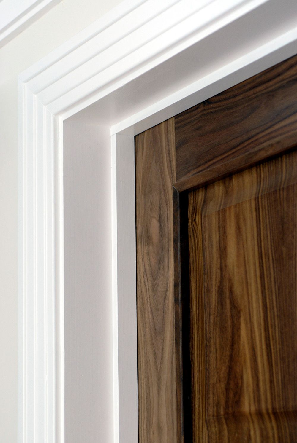 Walnut Model R109 With White Stepped Architrave
