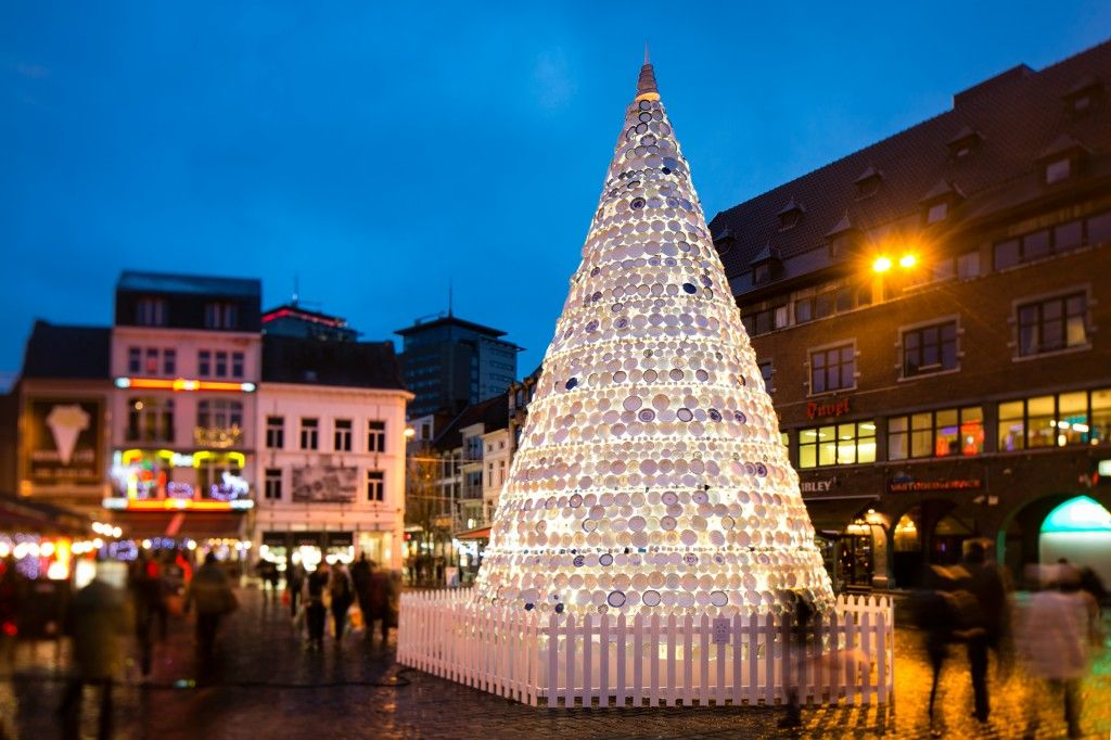Belgium tree, showing creative ideas for a community art projectFor the holiday season, they decided to create a stunning porcelain tree in their city of Hasselt, Belgium. A tree decorates the town square every year, but instead of cutting a live tree this year, Vanluyd and Vanbergen created the tree as a community art project.  They asked local residents to donate old white plates and cups (blue or gold trim was acceptable, too). Collaborating on the creative idea,