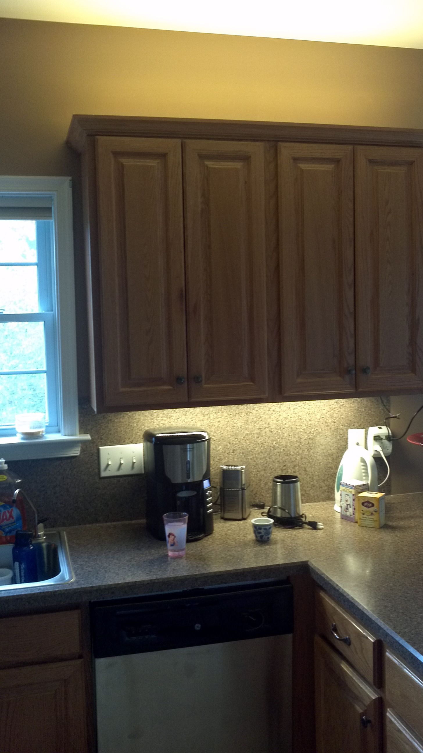 Under Cabinet lighting and indirect cove lighting up a kitchen with