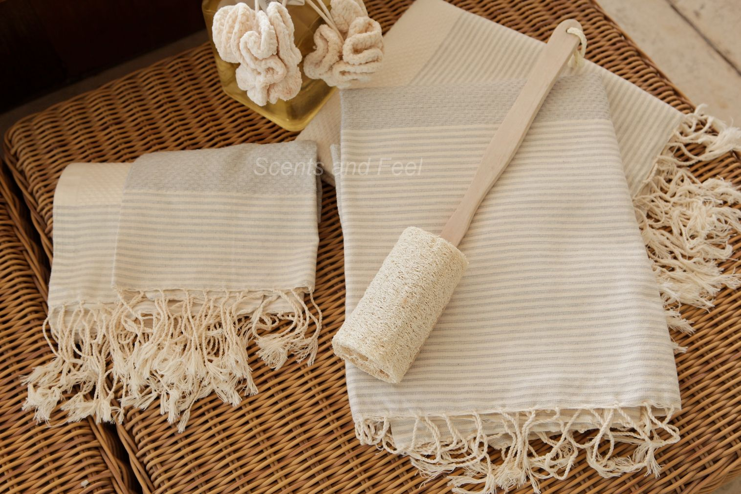 Fouta set. The 28x78 large size of the fouta makes it versitile in use. A blanket, throw, shawl, or towel it's softness and absorbancy is practical and luxurious.