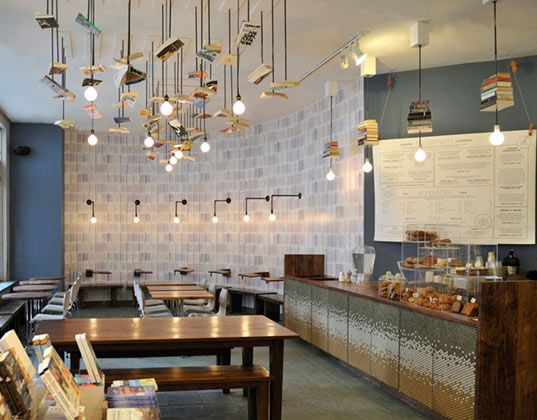 Bookstore Cafe Design Is Accented With Old Books With Images