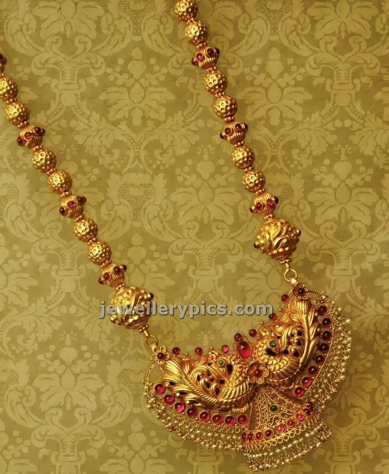 Gold long chain design with antique locket by Anmol jewellers ...