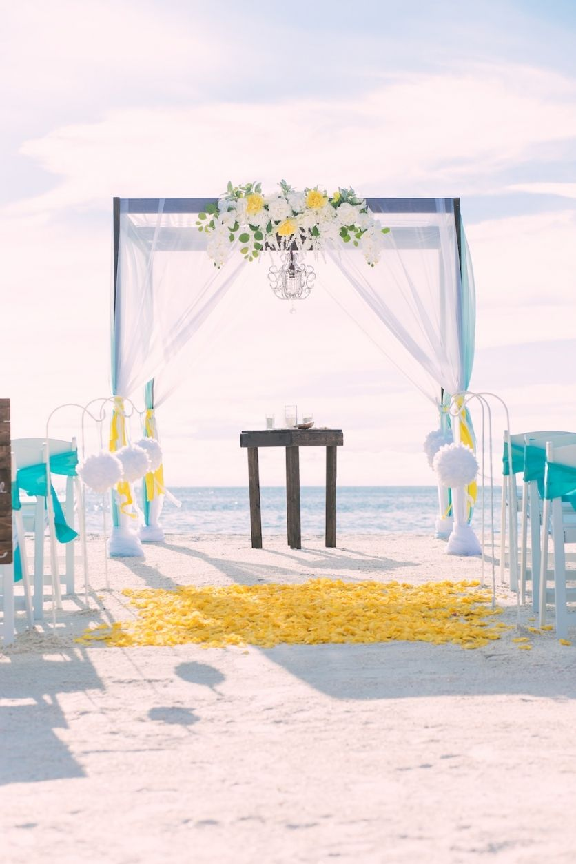Beach Wedding Ceremony Decor Wooden Alter With Yellow And White Flowers And Chandelier