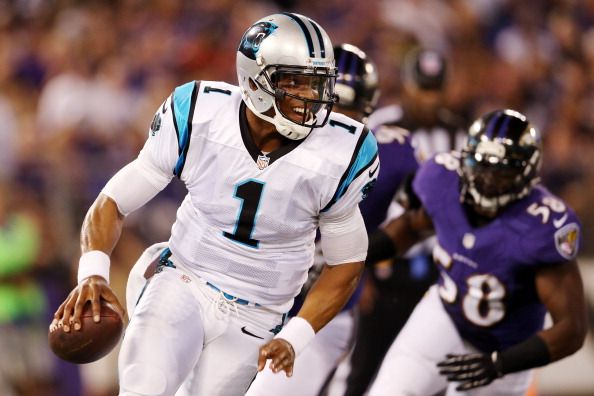 BALTIMORE, MD - AUGUST 22: Quarterback Cam Newton #1 of the Carolina Panthers scrambles away from linebacker Elvis Dumervil #58 of the Baltimore Ravens during the first half of a preseason game at M Bank Stadium on August 22, 2013 in Baltimore, Maryland. (Photo by Rob Carr/Getty Images)