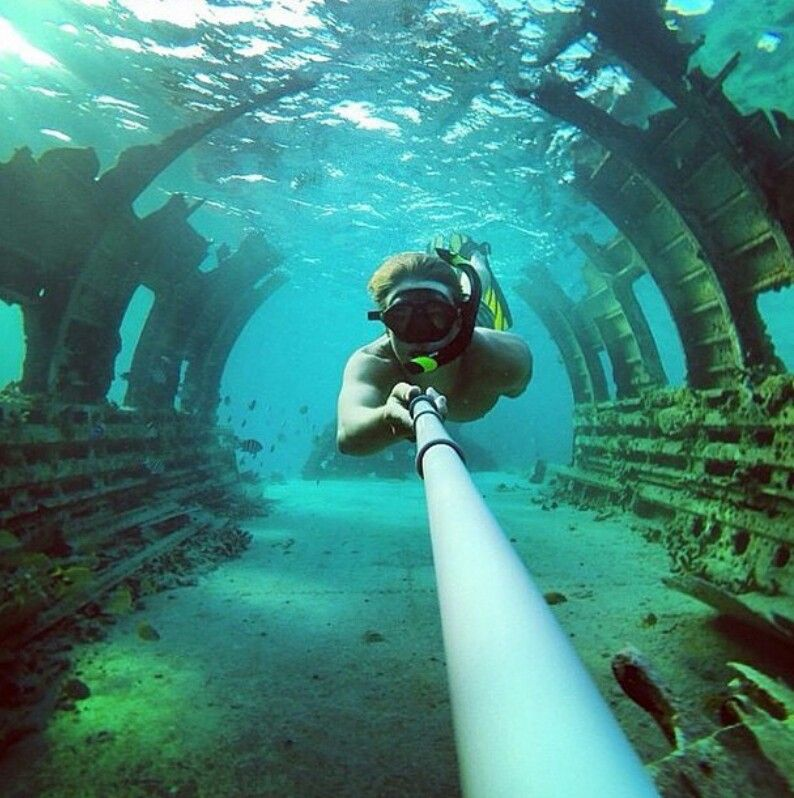 Freediving through the fuselage of a drug - running DC3 that crashed in 7th.    AWESOME!