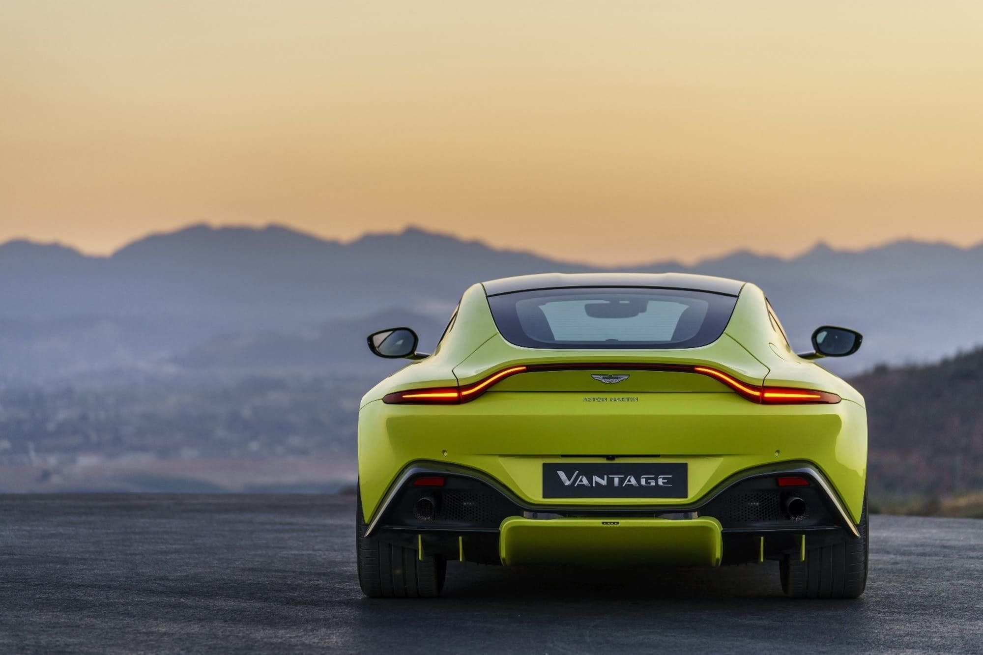 2018 Aston Martin Vantage Rear View With Unbroken Light Bar And Diffusers On Display Astonmartin Aston Martin Vantage Aston Martin New Aston Martin