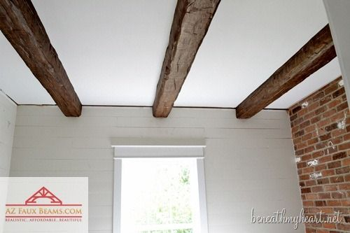fake ceiling rafters are a great way to add country character blogger traci of beneath my heart used artificial beams to dress up her bathroom and hide an - Fake Beams For Ceiling