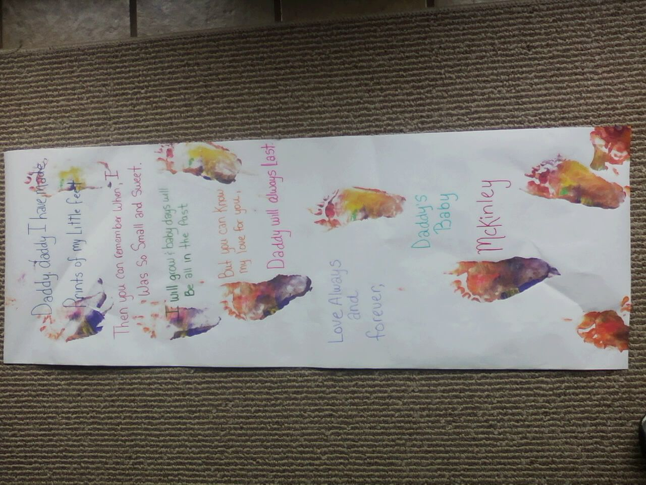 Painted foot prints with poem