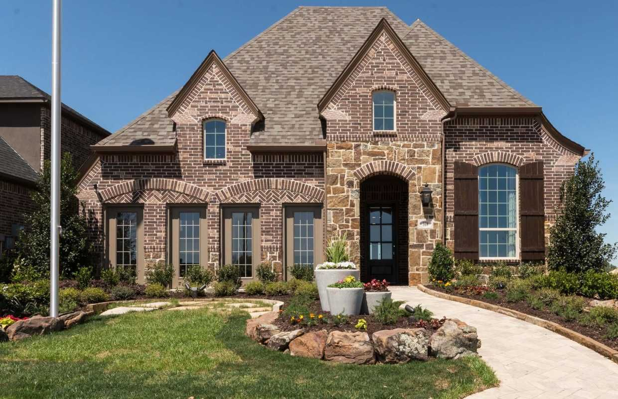 A Classic Texas Style Home With Beautiful Brick And Warm Stone Highlighted By Wood Accents Trinity Falls Highland Homes Texas Style Homes New Home Builders