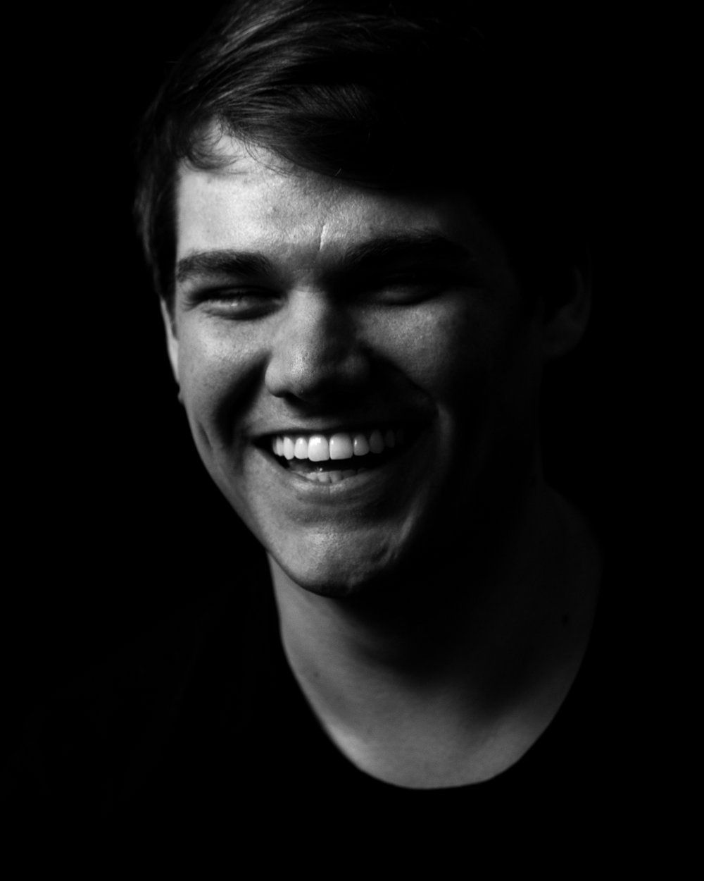 High contrast black and white male portrait laughter emotion
