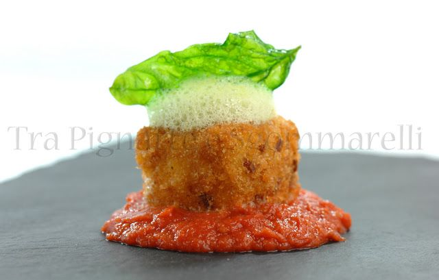Photo of Breaded buffalo mozzarella cube, with tomato sauce …