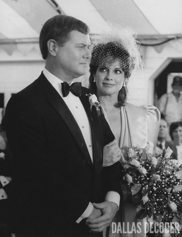 "J.R. and Sue Ellen (Larry Hagman, Linda Gray) prepare to exchange marital vows — again — in this 1982 publicity shot from ""The Wedding,"" a sixth-season ""Dallas"" episode. Read more at DallasDecoder.com."