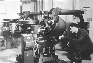 This is the pair of Mechau telecines used to show feature films from AP before the flying spot Cintel and EMI machines were developed. A 500w lamp illuminated the film and the continuous image looked into a standard Emitron camera.