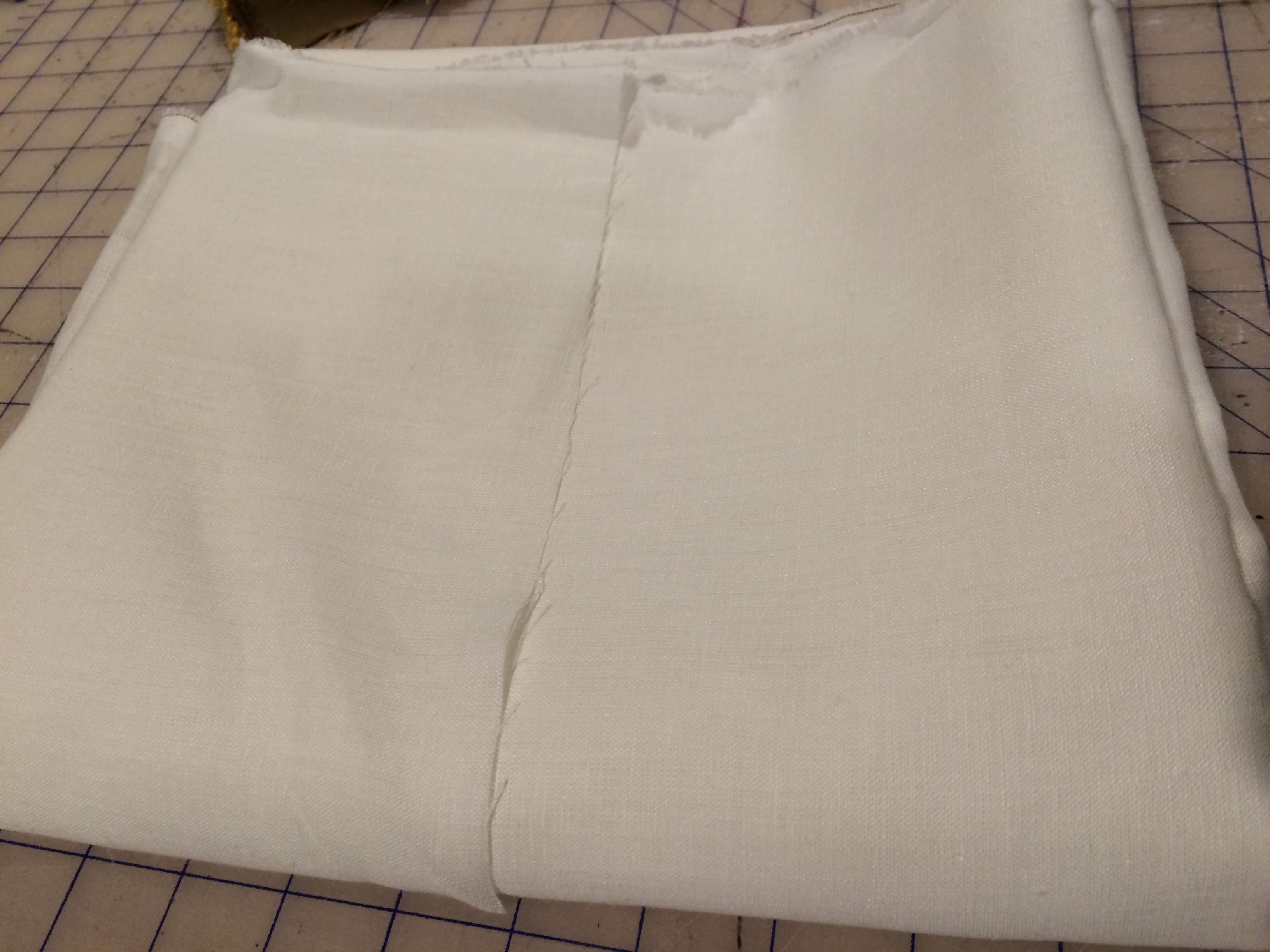 Fabric - softened white linen for blouse.  Source: fabrics-store.com