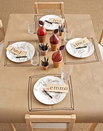 """Kid-Friendly Kraft Paper Tablecloth: butcher paper, table, markers. that's it! let them decorate it while they eat. especially a great idea for holidays! Saw this idea on """"Pantry Raid"""" on Netflix!"""