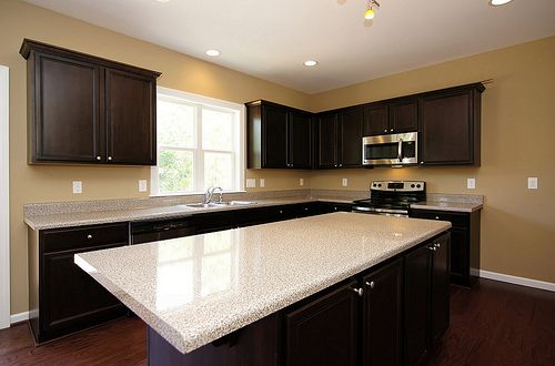Dark Cabinets Light Countertops And White Baseboard