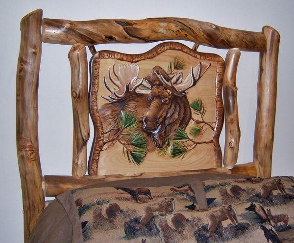 Detail of moose carving on aspen log bed headboard item