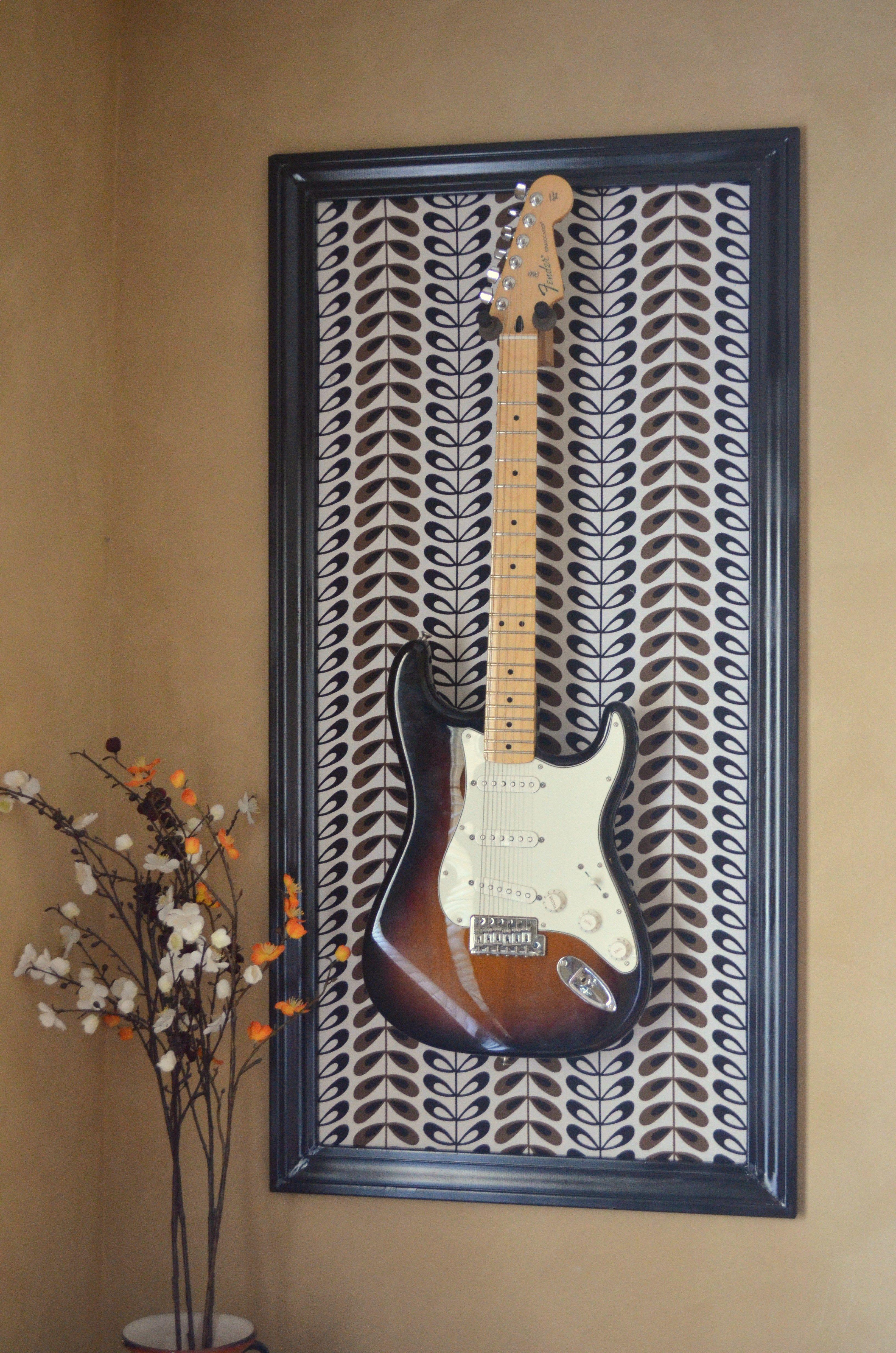 Guitar Hanger DIY guitar frame frame out of wood trim primed and