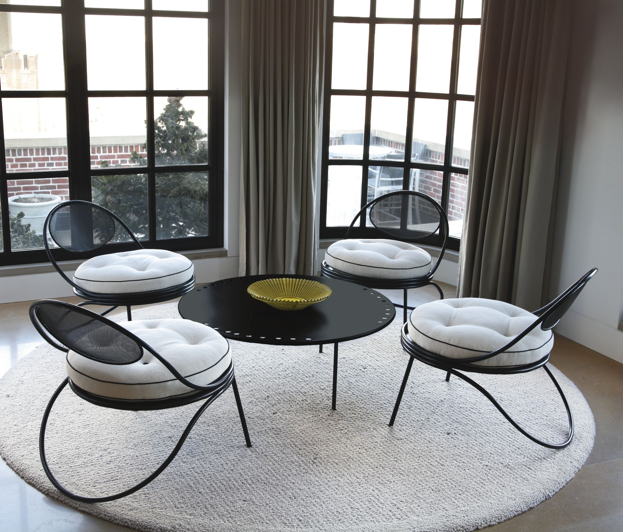 GUBI Copacabana table and chairs by Mathieu Mategot