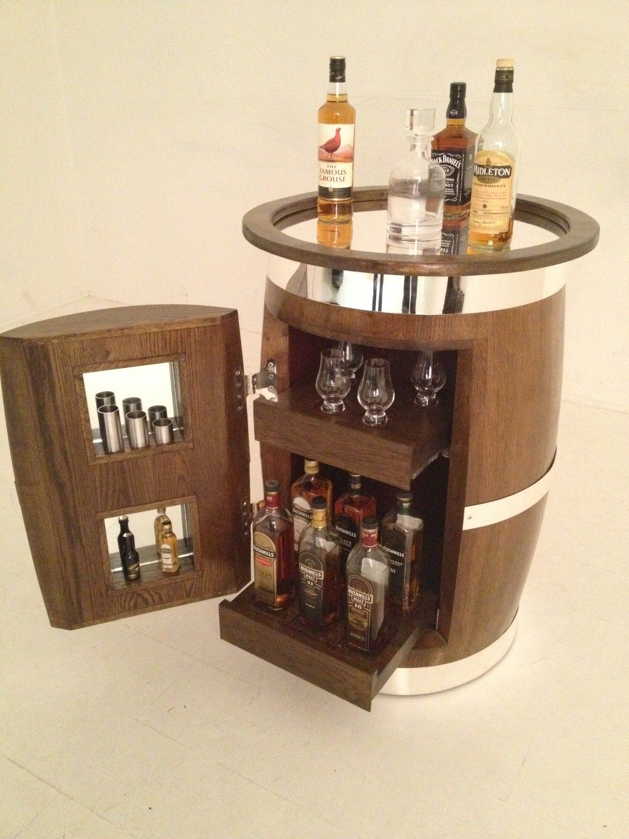 A whiskey cabinet made from the barrels of Old Bushmills Whiskey