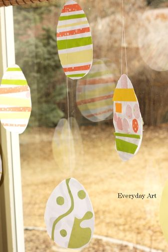 simply decorate easter eggs to hang by thread in the window