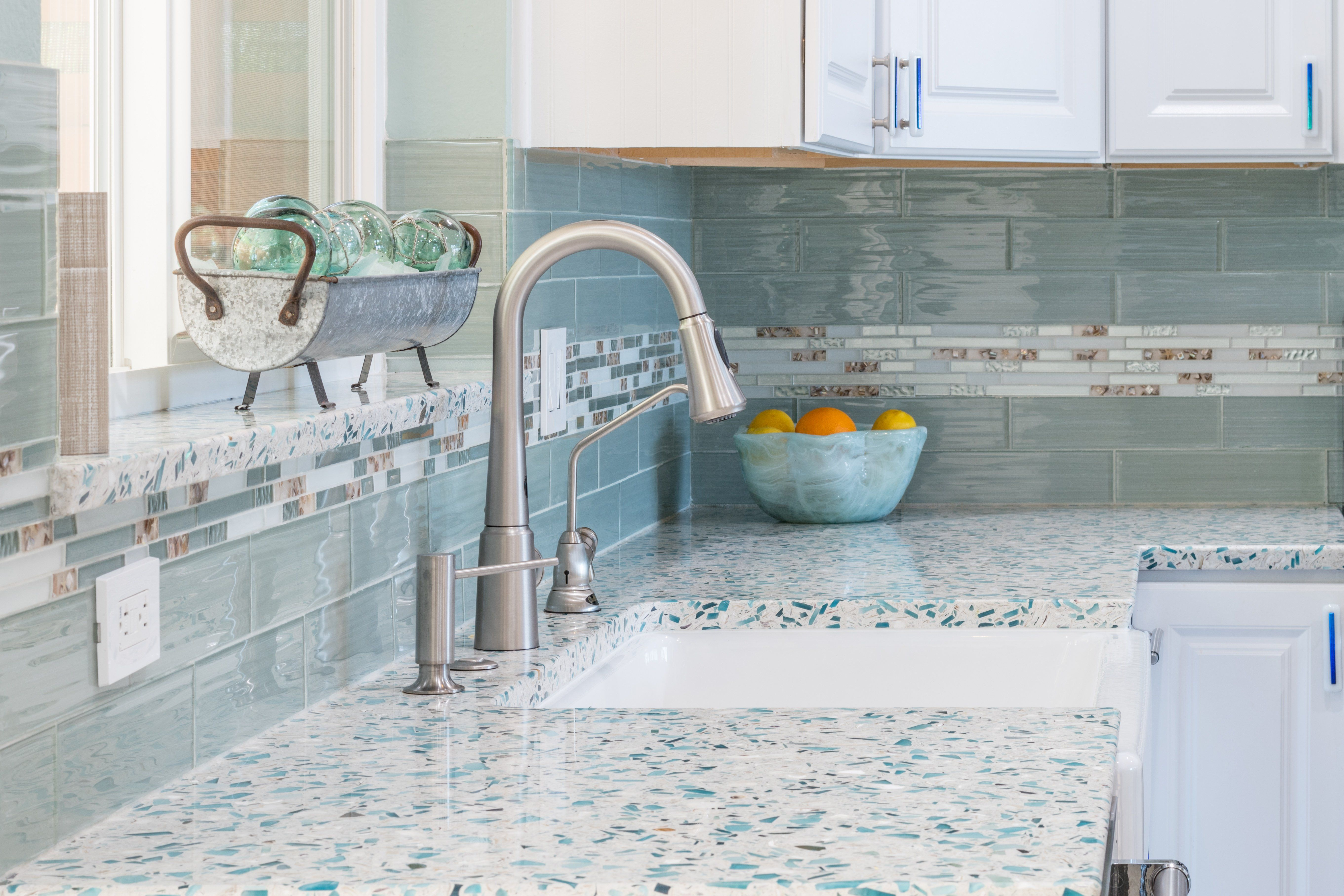 Cali Couple Brings The Beach Inside For A Coastal Kitchen With Turquoise Recyc In 2020 Replacing Kitchen Countertops Kitchen Remodel Countertops Coastal Kitchen Design