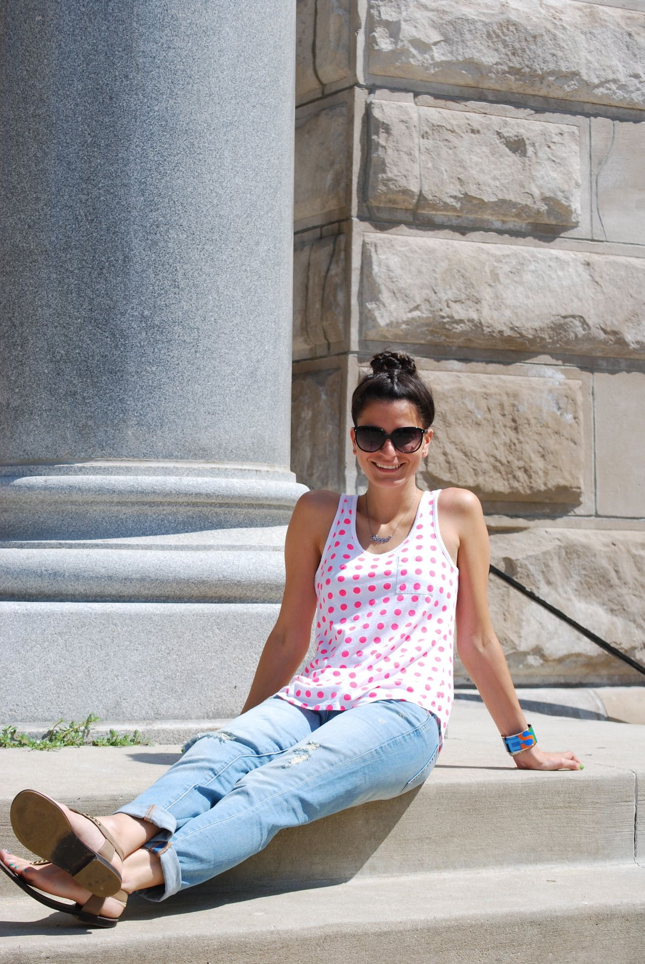 A pair of Gap jeans and a Gap tank as featured on the blog Hallways Are My Runways.