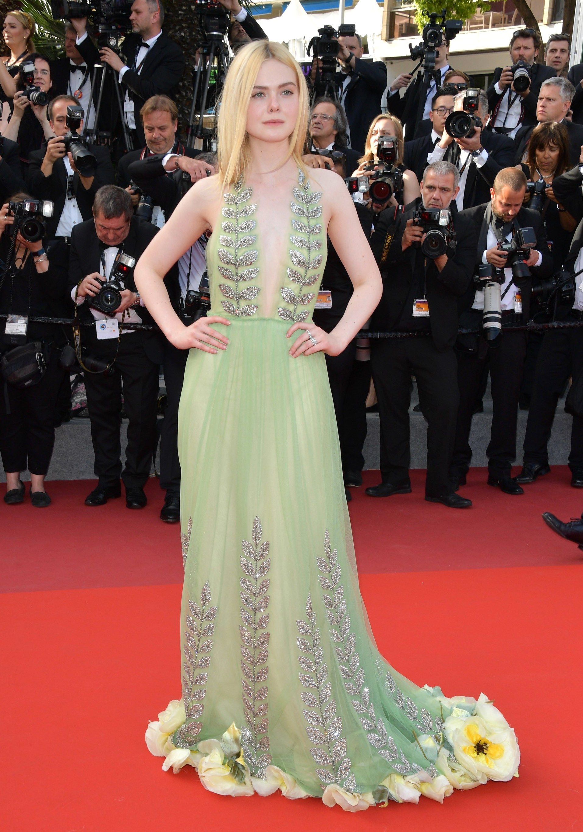Elle Fanning in a minted green Gucci halter dress with silver leaf ...
