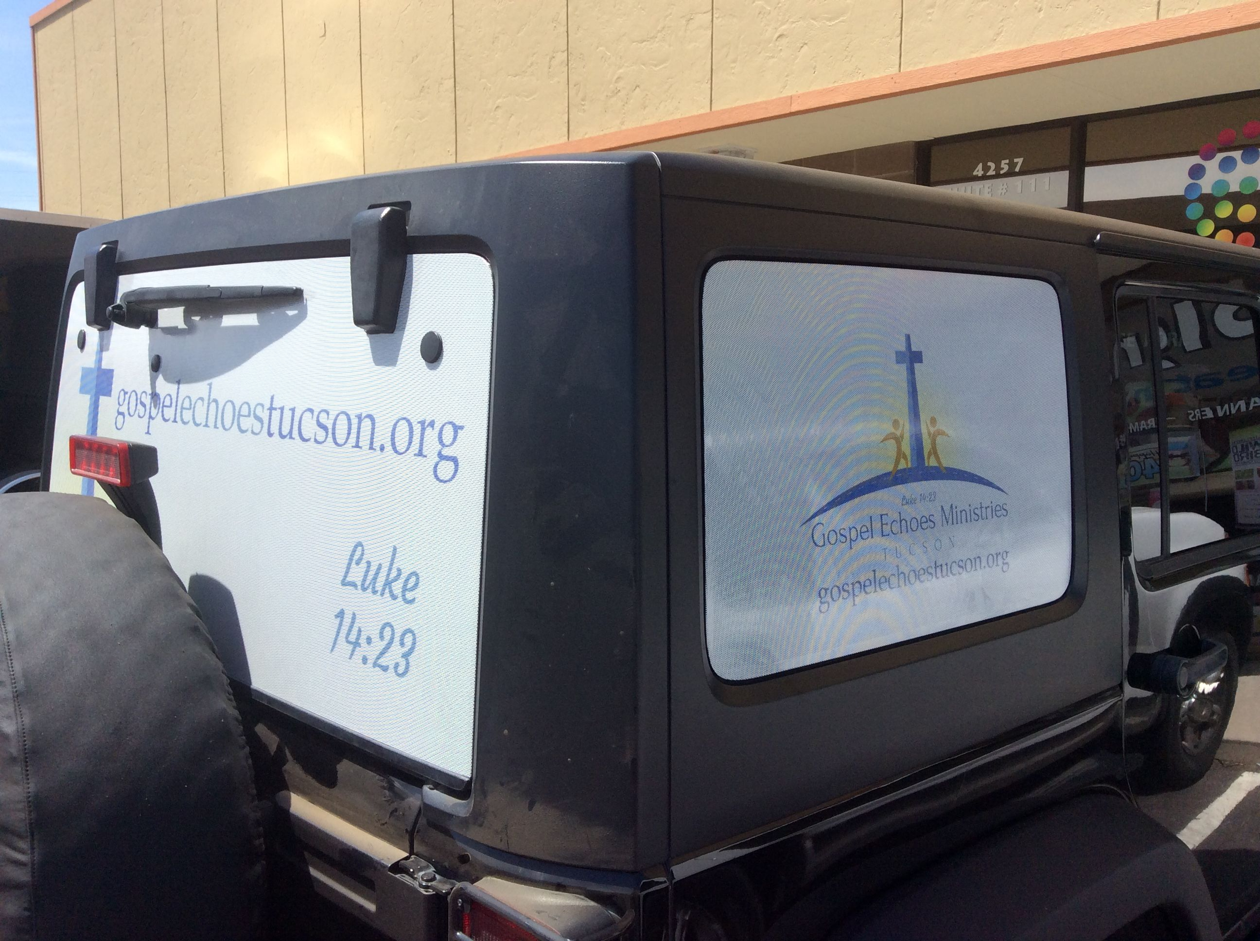 printed window perf graphics install on a jeep printing decals