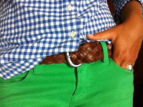 blue and white plaid shirt, brown belt, green skinny jeans