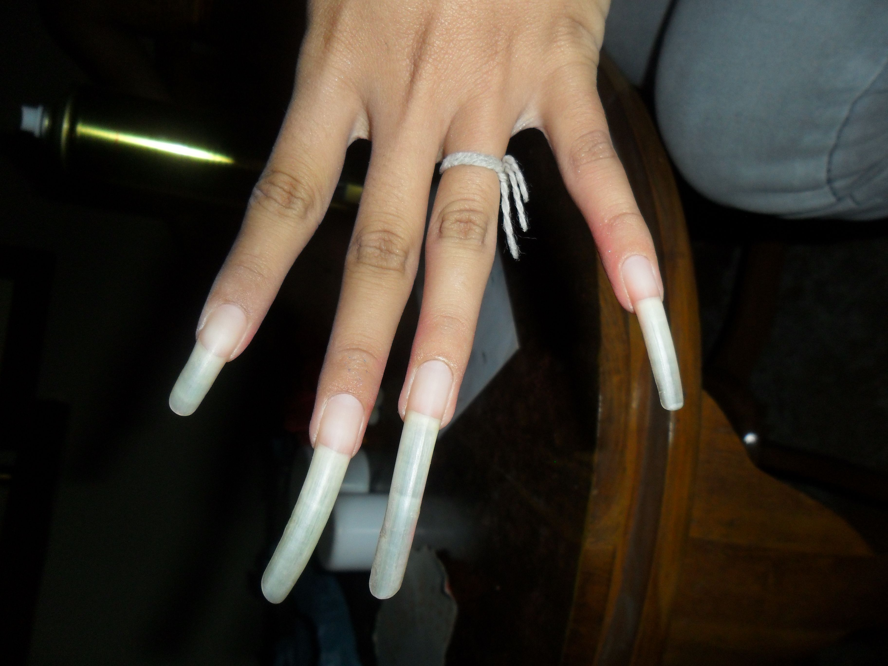 a dancers nails. in bali, women who have super long nails are known ...