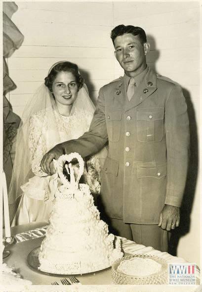 American soldier and his bride cutting their wedding cake. Gift of Norma Stewart, from The Digital Collections of the National WWII Museum, 2012.458.146.