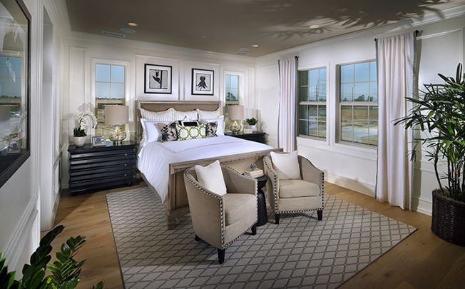 The generous master suite is a personal oasis enhanced by spa-like bath with large shower, soaking tub, dual sinks and his-and-her walk-in closets. - Residence 3X at Sheldon at Greenwood in Tustin, CA