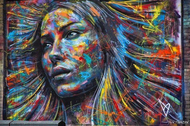 Framed Canvas Print  Banksy Style girl face painting street art wall graffiti