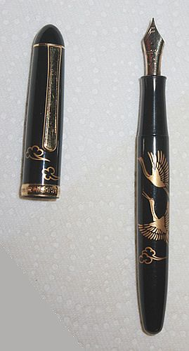Vintage Platinum Maki-e Crane fountain pen, Fine nib (equivalent to Western XF).  Founded in 1919 by Shunichi Nakata, Platinum is one of the three world renown pen companies based in Japan, the other two being Sailor, and Namiki-Pilot.  To anyone for whom the nib is THE factor in choosing a fountain pen, those three should be at the top of the list of brands to try.  Though Aurora and Delta, both of Italy, are hard to beat, the Japanese are THE most consistent!