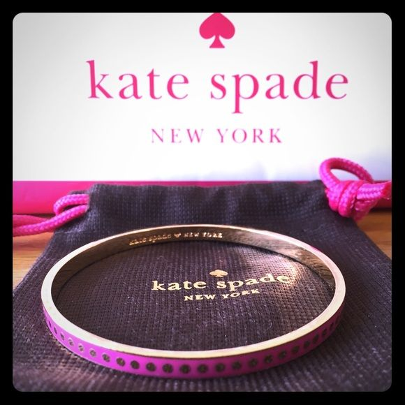 "Kate Spade Pink"" Etcetera, Etcetera"" Idiom Bangle Pre-Owned, worn bangle with very few scratches inside & outside of the bangle. Cute Gold Polka Dots go all the way around the bangle that has a base color of Pink (Fuchsia) Comes with Dustbag. kate spade Jewelry Bracelets"