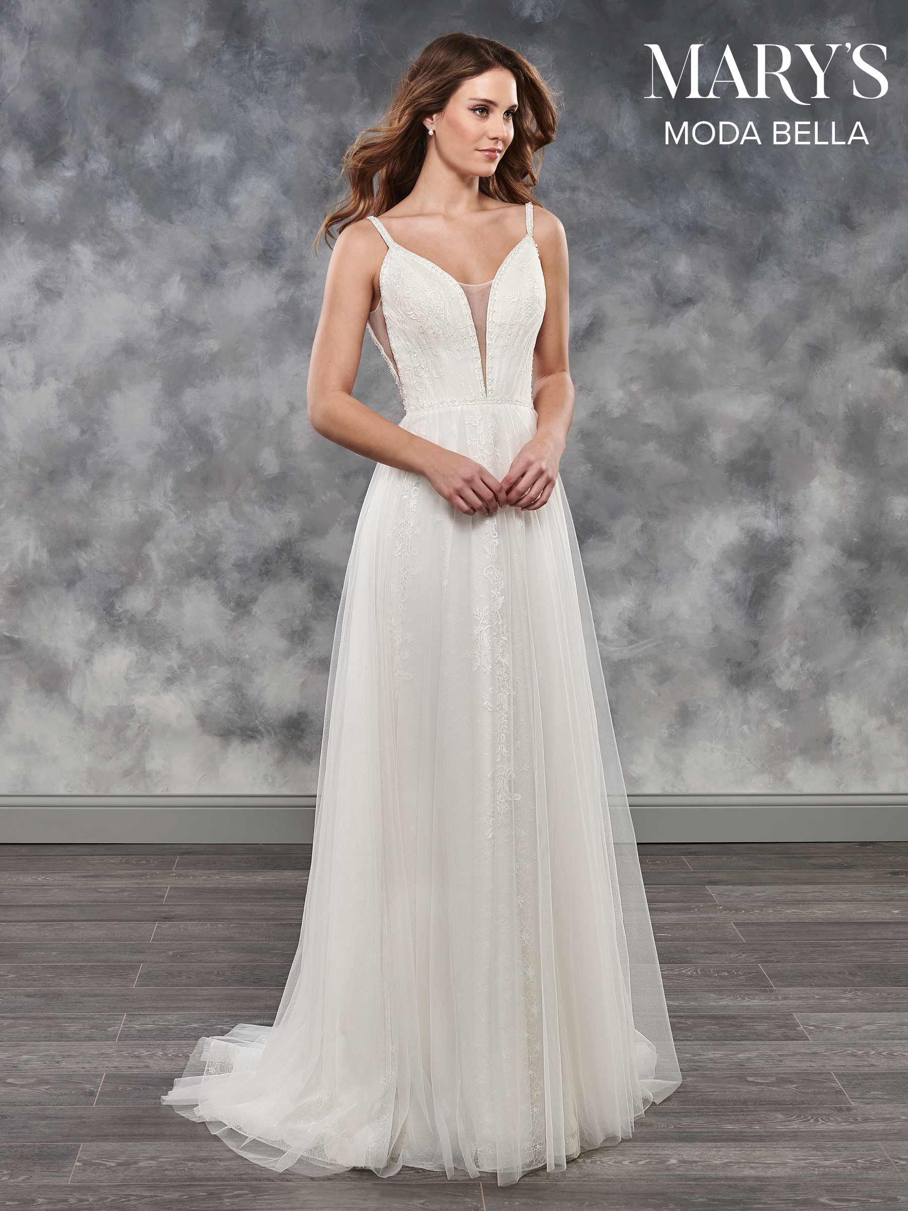Modern and elegant boho wedding dress layers of tulle and lace
