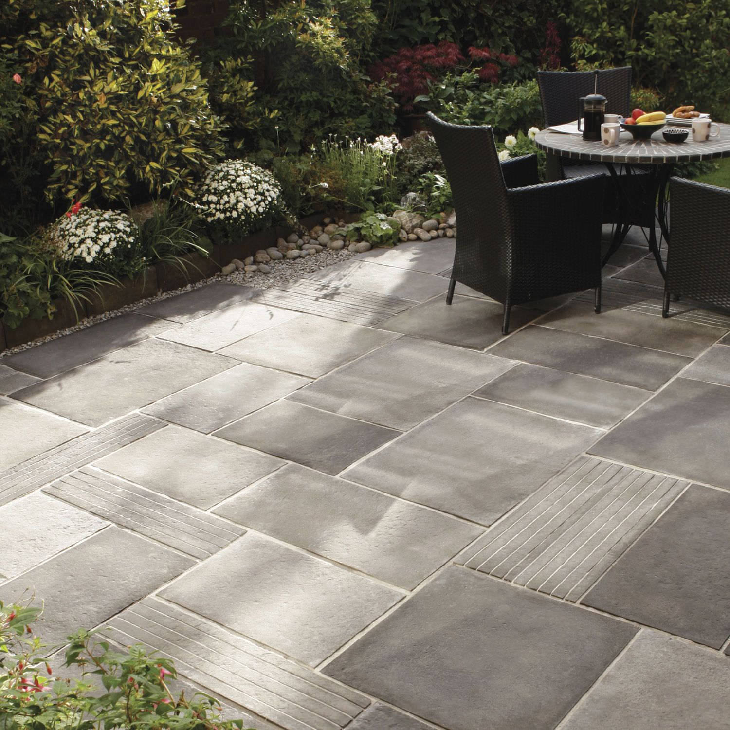 Engineered stone paving tile for outdoor floors for Garden patio design ideas