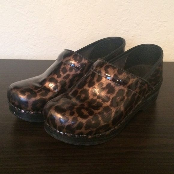 Cheetah Print Danskos  Retails $134.95 brand new. Really comfortable, still in really good condition too. Has a little bit of fraying on the edges of the leather, barely noticeable when worn. Other than that it's super trendy & cute!  Dansko Shoes Mules & Clogs