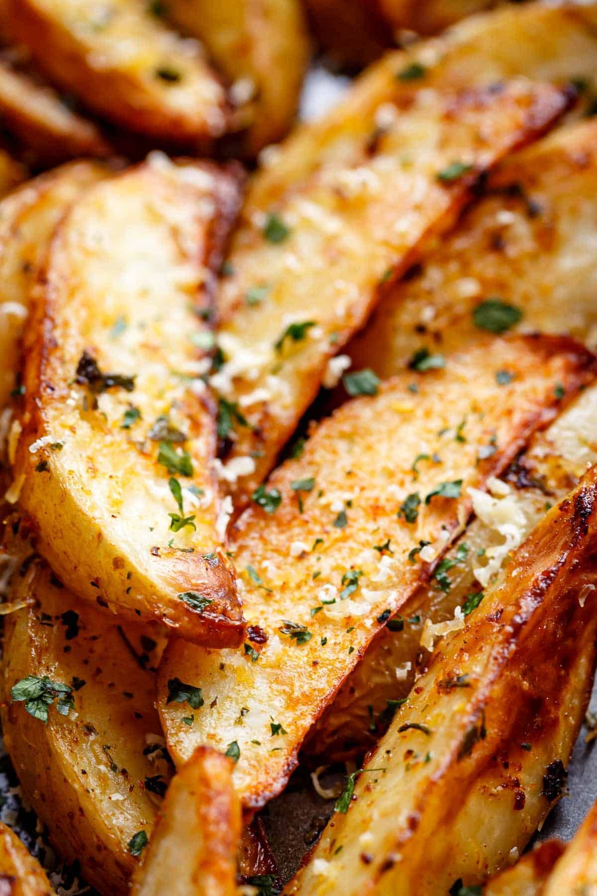 These Potato Wedges Are Baked Not Fried They Have Loads Of Cheese And Garlic And Are Soft And In 2021 Wedges Recipe Garlic Baked Potatoes Baked Potato Wedges Recipe
