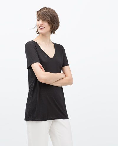 ZARA - WOMAN - EXTRA LONG T-SHIRT...$19.90 CAD. Composed of 100% lyocell. EXTRA LONG T-SHIRT, Drapey T-shirt,. Scoop neckline, Short sleeves.