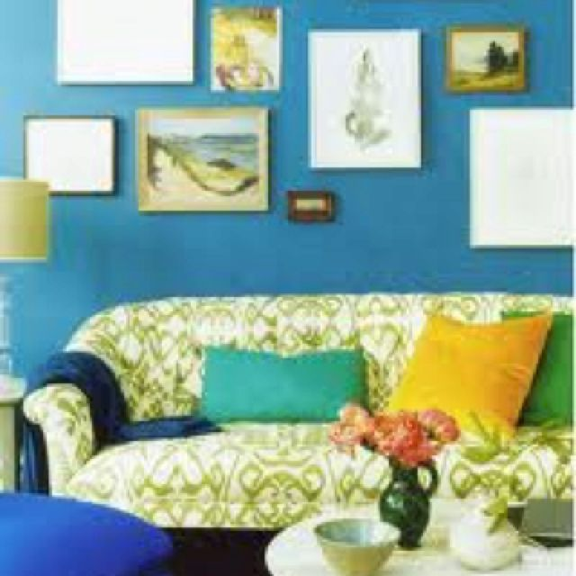 Pretty sofa and eclectic wall display.