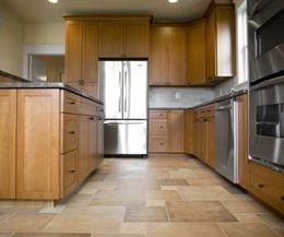 A Neutral Colored Tile Floor Is An Ideal Pairing For Light Maple Kitchen  Cabinets.