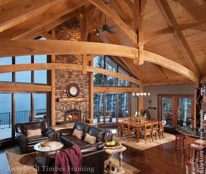 This lake home uses the large span of its timber trusses to create ...