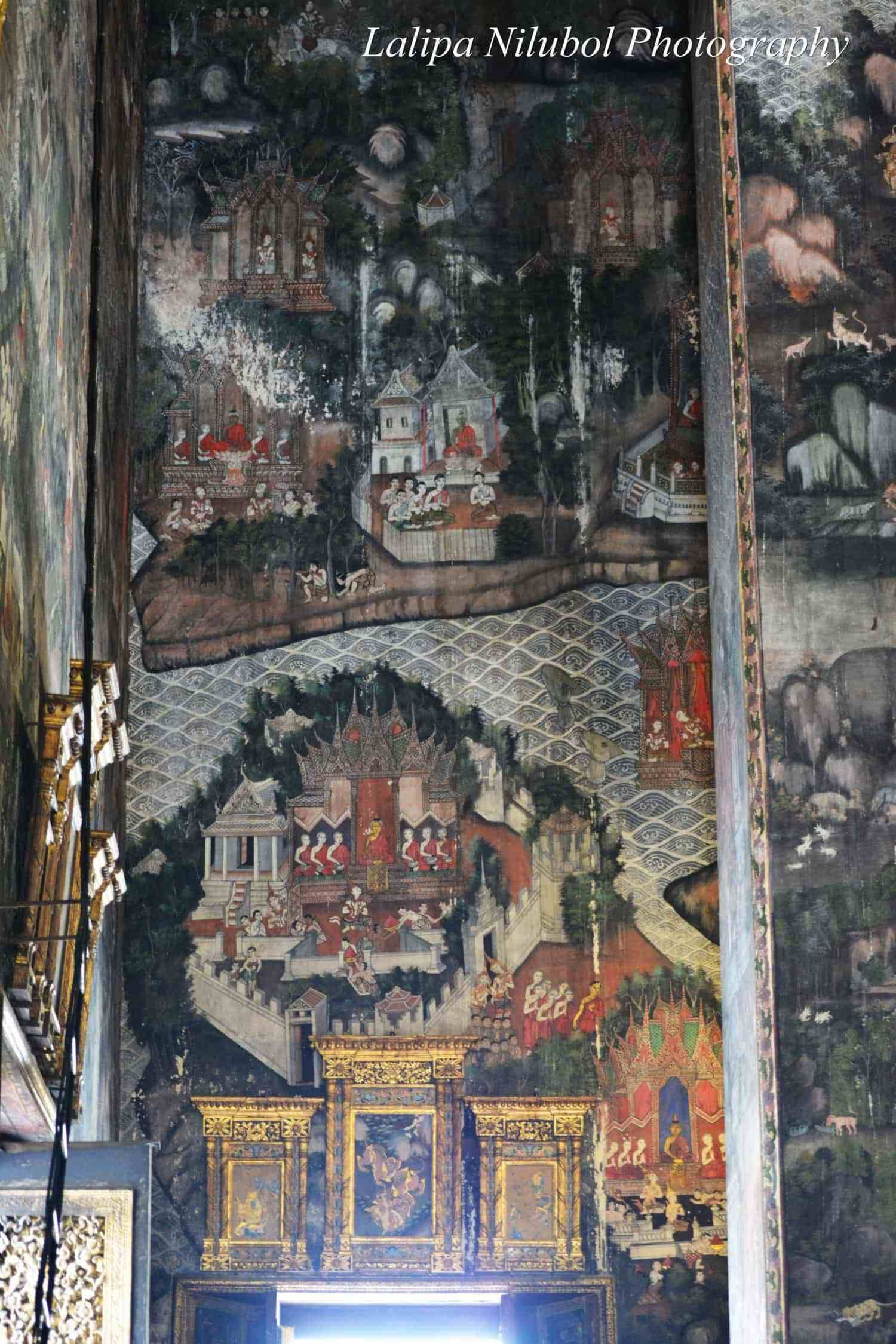 Mural paintings on the high walls of the front chapel in wat sutat