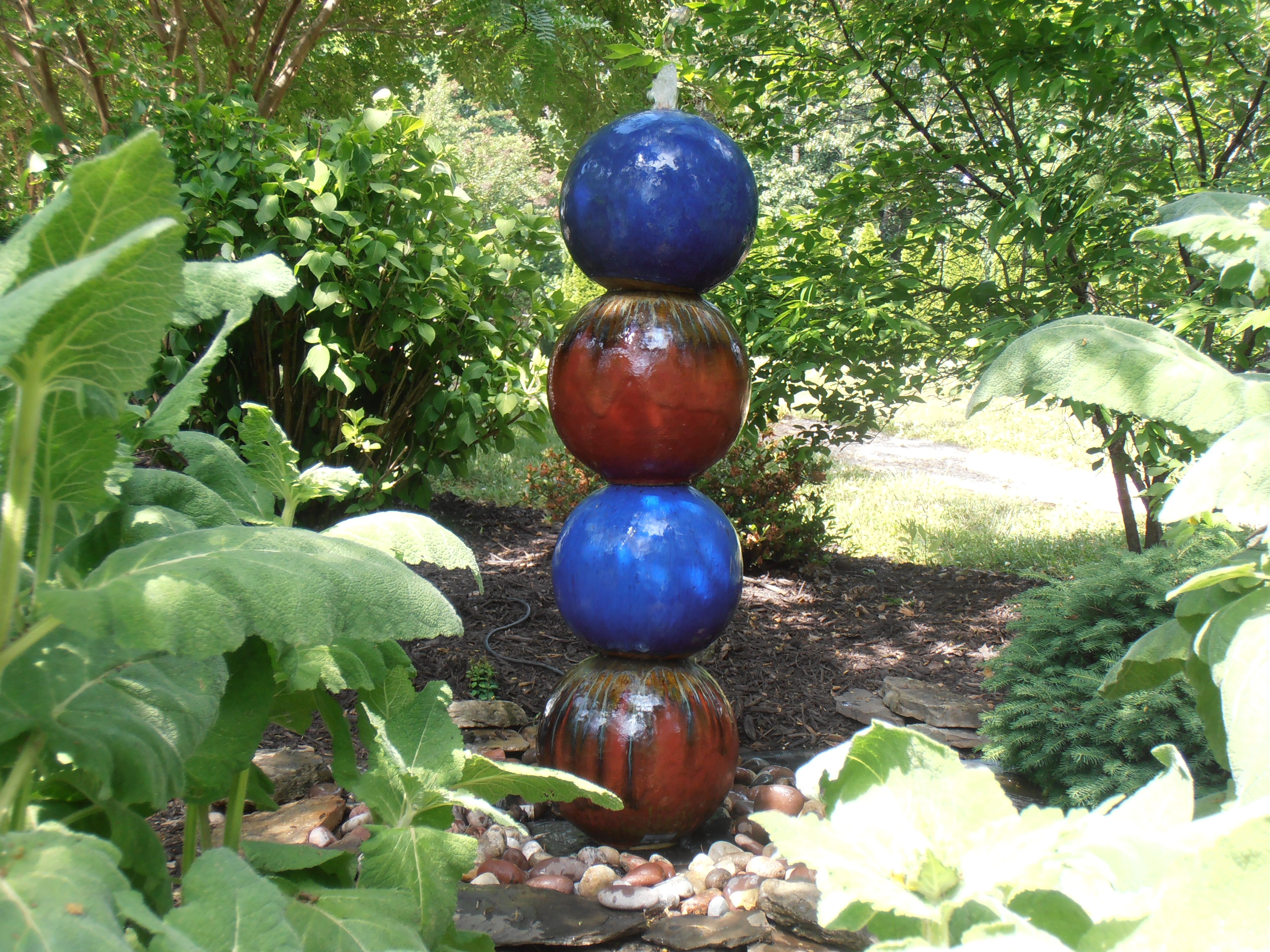 I took a few orbs drilled them at the top. Then took a slate piece drill it and mounted a copper pipe, slide the orbs over the copper pipe and just like that a new fountain style here at Southern Grace. On display on our garden walk. We Ship