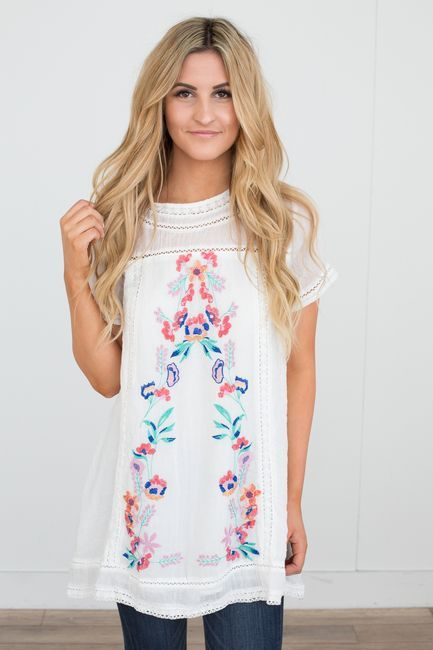 Shop our Floral Embroidered Tunic Dress in Off White. Featuring a button  back closure and crochet accents. Always free shipping on US orders!