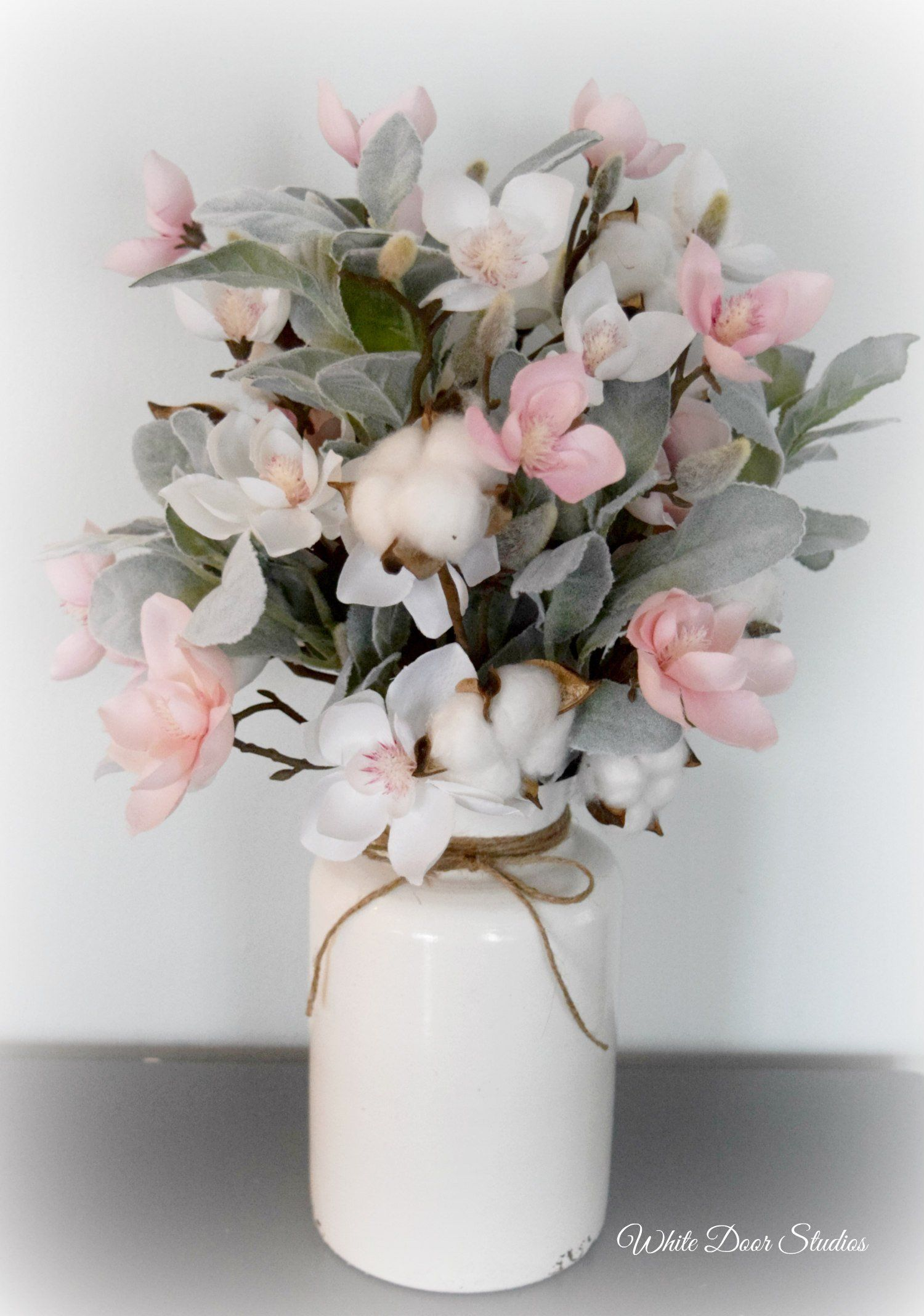 Magnolia And Lambs Ear Farmhouse Floral Arrangement With Cotton Stems Pink And White Home Floral Arrangements Spring Floral Arrangements Flower Arrangements