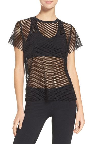 island mesh tee by ALALA. Cover up a bit but keep as cool and dry as possible in this netted crewneck that's both practical and edgy.