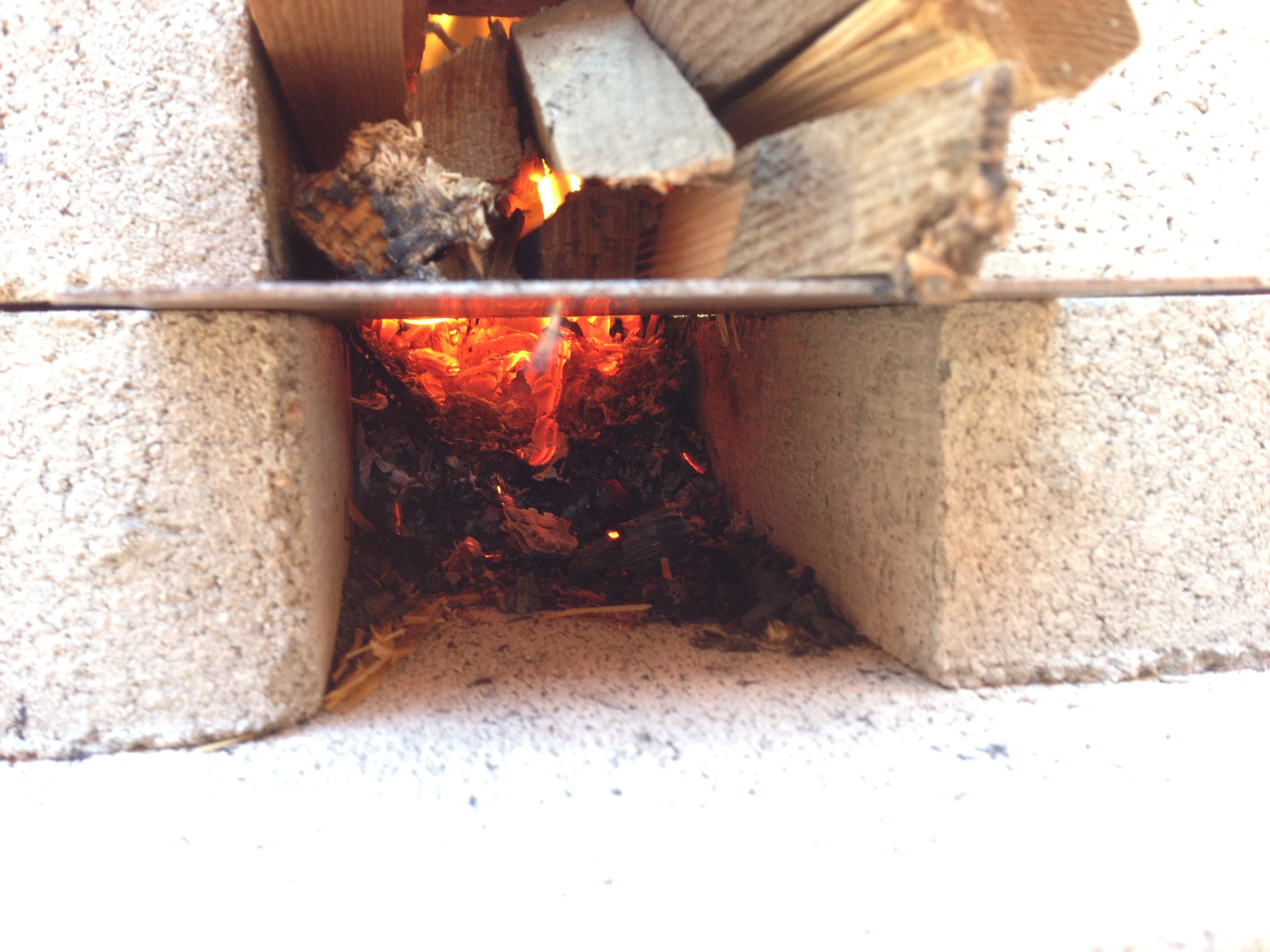 I Modified My Rocket Stove By Adding This Metal Plate Now You Can Add Tender To The Bottom And Put Wood Into Top It Gets Fire Started Without